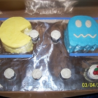 Pac Man  This was a corn allergy free cake for a customer....pac man was a 6 inch round and ghost was a 6 in square...cupcake dots and chocolate...