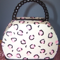 Purse Cake small purse cake made from an 8x3 round pan...fondant ball handle on wire.