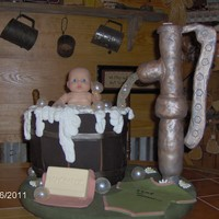 Baby In A Washtub Baby Shower I made this cake for my daughter's baby shower. Everything was edible but the baby. Water pump was made out of rice krispies covered...