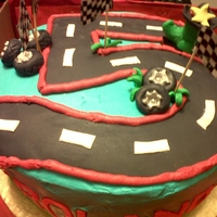 Cars Cake cake inspired by a super artist here at cake central, thanks for the inspiration! buttercream with fondant details. TFL