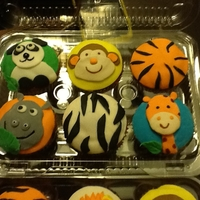 Safari Cupcakes Animal themed baby shower, there were 52 cupcakes, including some with the baby's name. thanks for looking.