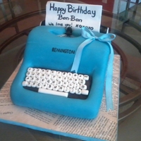 Remington Typewriter Dark Chocolate cake with Hazelnut buttercream frosting, covered in MMF- paper made of GP and MMF mix.