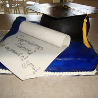 Graduation Cap And Diploma I made this for a friends husband who graduated with his Masters. The Diploma is made out of gum past along with the top of the cap.