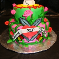 Ed Hardy Love This cake was fun to make! I love all the bright colors and different designs. The daggers through the heart where by far the most...