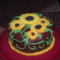 Sunflower Cake   Double layer yellow cake covered in fudge frosting with sunflowers.