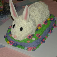 Bunny Cake   Banana cake covered in buttercream with fondant flowers and chocolate eggs.