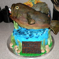 Birthday Cake   Chocolate cake with buttercream frosting. Fish is RCT covered in MMF and airbrushed.