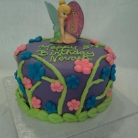 Tinkerbell Cake 6 inch strawberry cake with buttercream filling, covered in fondant with gumpaste flowers, leafs and branches