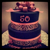 Pink Animal Print Birthday Cake   Leopard print ribbon was used as a border. For more pictures of our cakes, visit our website: www.simplysweetonline.com