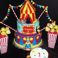 Circus Themed Birthday Cake, Smash Cake, & Popcorn Cake Pops  Birthday cake has several figurines made of fondant/gumpaste. Smash cake is covered in buttercream and fondant dots. Cake pops were made to...