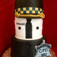 Police / Sergeant Promotion Cake Top hat is made of cake and carved to resemble sergeant hat for the Chicago police dept. White collared shirt had sergeant insignia on...
