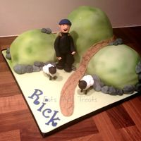 Hiker/rambler 3D Cake 3 x sponge cakes, filled and sculpted. Modelling paste hiker and sheep