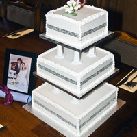 3 Tier Ruby Wedding Cake This was a replica of my Mum and Dad's original 1970's wedding cake made to celebrate their Ruby Wedding. Bottom dummy tier, Rich...