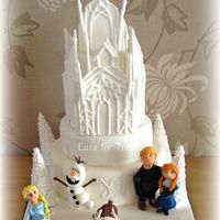 Frozen Ice Palace Cake 4 tier chocolate sponge cake. Ice Palace made from piped modelling paste. All characters made from modelling paste