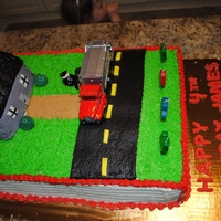 Garbage Truck Cake 4th Birthday cake for my son. House is RKT covered w/ fondant. Garbage bags are also fondant. I messed up the fondant. I used too much...