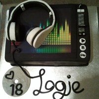 Sound Deck And Headphones This cake was made for a DJ friend of my daughter's. Headphones made of fondant, equalizer printed on rice paper. Banana cake used,...
