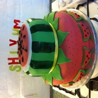 "Fruity Cake Bottom tier 10"" chocolate cake with oreo buttercream. decorated as a strawberry.Top tier 7"" vanilla cake with vanilla buttercream..."