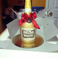 Hennessy Bottle Cake   Vanilla pound cake filled with white chocolate butter cream and covered in fondant. It was very yummy!!!