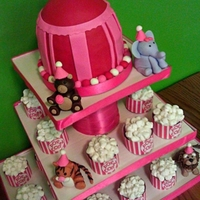 Circus Cupcake Tower Circus Cupcake Tower with 'popcorn' cupcakes and circus tent cake topper. Fondant animals