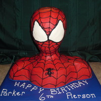 "This Spidey Loves Cake! Styrofoam head, 2 10"" rounds and 1 8"" round vanilla and chocolate cake with VBC icing."