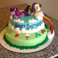 My Little Ponies A cake for my boyfriend's brother's birthday. My first time trying to make any 3d figures. Next time need to add more gumpaste...