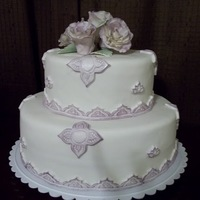 Victorian Rose Cake Two tiered vanilla cake covered with fondant and victorian trimmings.