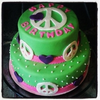 Hippie Birthday Chocolate cake filled and covered with chocolate buttercream. fondant decorations flavored as chocolate too.