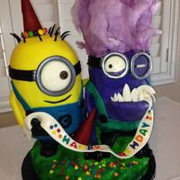 Minion Cake This has both minions. The hair is made from cotton candy. I did learn you can air brush cotton candy without affecting it as long as you...