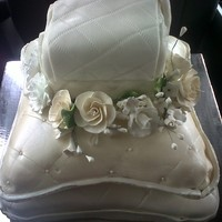 Bridal Showe Cake I made this for a bridal shower, its a simple pocketbook on top of pillows surrounded by roses.