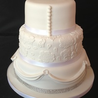 Swags Lace And Pearls Three tier wedding cake inspired by the brides dress.