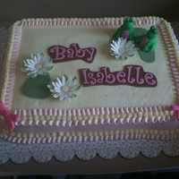 Baby Frog Cake A cake made to reflect the nursery. Frog's done in green, brown, pink and yellow. Ruffle boarder on the slab cake inspired by Corrie&#...
