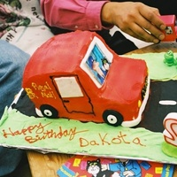 Postman Pat Van  this is one of the first novelty cakes i have ever made, back in 2003. sponge cake shaped into van, buttercream frosting, fondant for...