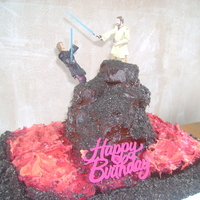 Star Wars Cake   sponge cake, with cupcakes stacked to make the mountain. buttercream frosting and crushed oreos for dirt. plastic figures