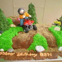 Quad Bike Cake  sponge sheet cake with cake used to make hill affect. buttercream frosting with fondant for 'roads' and mud, cookie crumbs for &#...