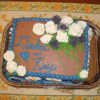 Bissonett Reception Cake   chocolate frosting made with melted Dove sqaures, royal icing roses.
