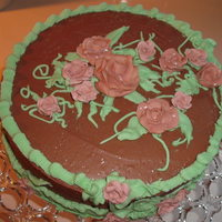 Roses,royal Icing, Chocolate Buttercream I mixed neon purple liquid food color with neon green and got this rose color..
