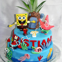 "Sponge Bob Cake  I make this Sponge Bob Cake for my godson Christian. It is a vanilla cake fondant covered and ""all"" figurines are made in gum..."