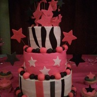 Sweet 16Th Birthday Cake for a sweet 16th with cupcakes. Butter cream icing with fondant decorations.