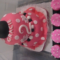 2 Year Old Minnie Mouse Style Tiered Cake With Matching Cupcakes   Tiered Cake with Mouse Hat with bow on top with matching cupcakes, pink and white fondant with buttercream cupcakes