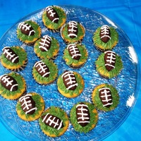 Chocolate Truffle Football Cupcakes  Chocolate truffle footballs on vanilla cupcakes injected with Nutella filling. Kids loved the cupcakes. Ran out of time and had to rush my...