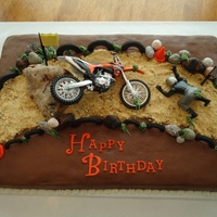 "Motocross ""wrecked"" Cake My son rides motocross motorcycles and recently had a serious accident, breaking 6 bones, concussion, etc. We are thankful he was..."