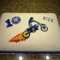 Yamaha Dirt Bike In Flames My youngest son loves his motocross dirtbike and he wanted a birthday cake to match. The design was actually derived from a wall mural that...
