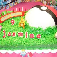 Pokemon Cake This was my very first fondant/icing mix cake. My daughter loves Pokemon! The ball is the soccer ballcake covered in fondant. Jasmine'...