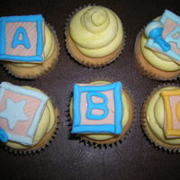 Baby Shower Cupcakes lemon zest cupcakes and buttercream decorated to match invitations