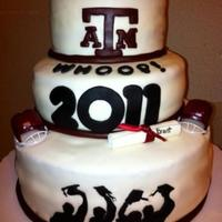 Texas A&m Graduation Cake I made this cake for coworker's son. First tier is White cake, sencond is Red Velvet, and bottom tier is Chocolate. It's all made...
