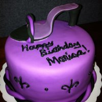 Purple Diva Chocolate cake covered in MM fondant. High Heel is made out of Gumpaste.