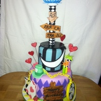 Alice In Wonderland Alice in Wonderland Cake. Showing many elements of the movie such as the pocket watch, the mad hatter, the Ace of Hearts and Ace of Clubs...