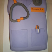 Nursing Grad First time Nurse scrub cake & 1/2 pillow cake. Made MMF from CC recipe. yummy. Overall pleased with cakes