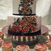 Funky Roses two tier, hand painted Art Nouveau style roses with matching cupcakes.