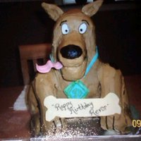 3D Scooby Doo This was my first attempt at a 3D cake, with the help of my oldest son. This is before I learned the pros were using rice cereal treats to...